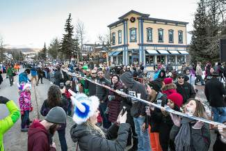 Folks line up to be part of the Ullr Fest shot ski world record in Breckenridge.