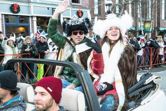 Ullr royalty wave at their Kingdom as they cruise down Main Street in the Ullr Fest parade.