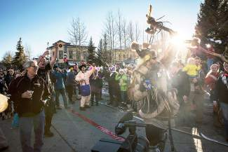 Revelers gather around Ullr before the Ullr Fest parade on Main Street in Breckenridge.