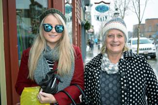 Maddie McGillick, left, and Meredith Gordon, walk down Main Street  on Thursday, Jan. 7. The two are visiting Breckenridge, where Gordon owns a home, from South Australia.