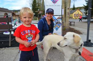 Matthew hangs out with Sunny the dog and owner Lisa Sirabella.