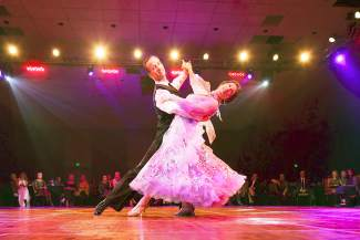 Deb Zimmerman, local, dances with Todd Hansen, a professional dancer, at the eigth annual Dancing with the Mountain Stars Saturday, Sept. 26.
