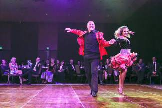 Johnny Pfeiffer takes the stage with professional dancer Ashley Galvan at the eighth annual Dancing with the Mountain Stars Saturday, Sept. 26. Pfeiffer won judge's choice award at the event.