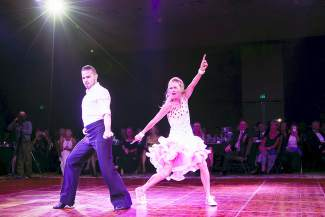 Jodie Taylor dances with professional dancer David Oliveri at the Dancing with the Mountain Stars event in Keystone Saturday, Sept. 26.