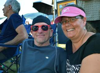 Summit Cove residents, Phil and Ann Minahan, take a break from dancing to the funky tunes of Funkiphino at the Fall Fest event on Saturday, Sept. 12 at the Frisco Bay Marina. A portion of the proceeds from the beer garden benefited The Friends of the Dillon Ranger District.