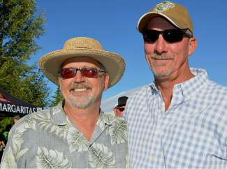 Frisco Mayor Gary Wilkinson and friend Bill Petty enjoy the tunes and the sunshine at Frisco's Fall Fest on Saturday, Sept. 12. This year the event moved to the Frisco Bay Marina and was reporting.
