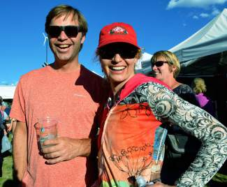 Summit County locals John Feather and Shawna Henderson take a break from the trails to listen to some tunes and enjoy the festivities at the Fall Fest on Saturday, Sept. 12.