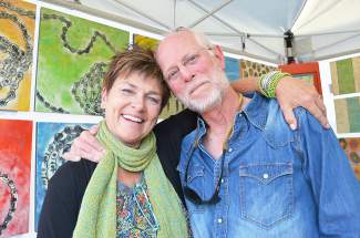 Artist Victoria Eubanks and her husband were on hand to meet, greet and sell Dawn's paintings as part of this year's Fall Fest in Frisco.