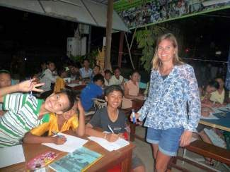 Leslie Davison, a longtime teacher in the Summit School District, took a year off to teach Spanish abroad in Singapore. The opportunity also provided for a side trip to Cambodia. She is shown here with her Cambodian students.