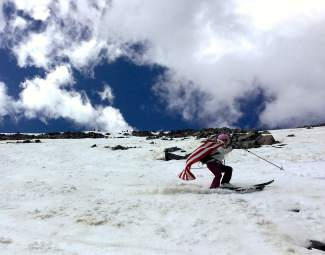 Pro skier and mountain biker Dave Bottomly makes the most of summer turns at Fourth of July Bowl after hike-biking the Tenmile Range from Peak One to Peak 10 on July 4.