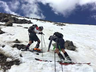 Grandad clips in (right) with his son at Fourth of July Bowl before the family's first turns on the mid-summer snow of Peak 10.