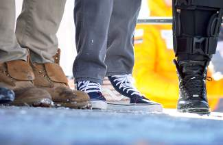 Footwear on the podium during the U.S. Ski Team naming ceremony in Copper on Nov. 21. The event (plus plenty of fresh snow) drew several hundred spectators.