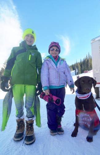 Young ski racer Auden Pankonin (left) and his sister, Amelie, with the official U.S. Ski Team mascot, Champ, before the U.S. Ski Team naming ceremony in Copper on Nov. 21. Auden won the #whatmakesachamp social media contest and got to spend the day skiing with Olympian Ted Ligety.