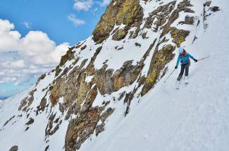 "Big-mountain skier Michlele Koss of Wildernest descends a steep, north-facing chute known as ""The Emperor"" from the top of Torreys Peak (14,275 feet) early in the morning on May 30. The day began with a pre-dawn hike and a long skin up the 14er with a small group of other area backcountry skiers. May in the Continental Divide area (home to Torreys and neighboring Grays) brought over 5 feet of new snow to both 14ers and other stretches above tree line — more than the snow totals for January and February combined."