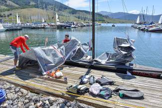 Rigging the sail: Mark Reece of Aspen and Patrick Burke of Colorado Springs prep a sailboat before the first day of racing on Aug. 8.