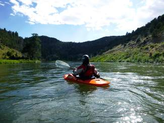 Bluebird day on the Colorado: Summit local Amy Airey paddles through the serene Class I and II waters of the Colorado River on a trip from El Rancho to State Bridge in Eagle County.