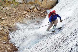 Rocks, dirt and snow: Gary Fondl of Frisco notches another month of skiing to record 60 months in a row with mid-September turns on the Skyscraper couloir, found north of Rollins Pass in the Indian Peaks Wilderness.