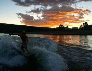 Riding the res: Longtime local Billy Anthony surfs during sunset at Green Mountain Reservoir for his 46th birthday on Sept. 20, also the final day of 2015 boating season at the reservoir.