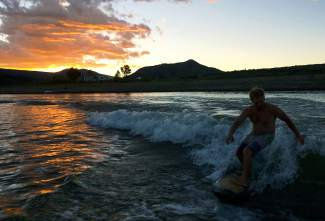 Rocky Mountain surfing: Billy Anthony rides the wake for his 46th birthday at Green Mountain Reservoir in September.
