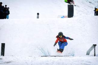 A young snowboarder skims the pond at Red Bull SlopeSoakers at Copper Mountain in 2015. The event returns this season for closing weekend April 16-17.