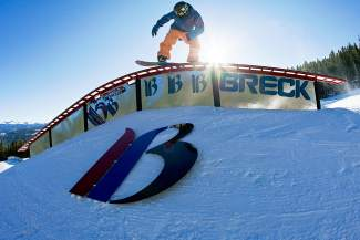 A snowboarder hits the Park Lane rails at Breckenridge. This spring, the Breck park crew hosts an open rail jam every Friday with prizes, free hot dogs and more.