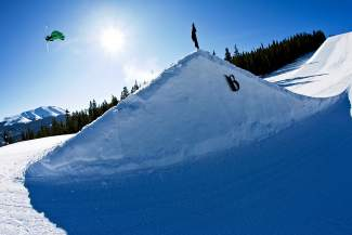 A skier floats over the final Freeway jump at Breckenridge. The resort's terrain parks host several ski and snowboard events this summer, including the Mountain Dew Open on April 2 and free rail jams every Friday in April until closing day on April 24.