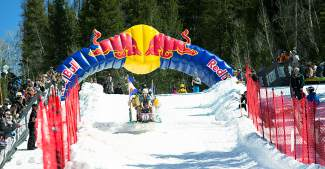 A rigged-up sled barrels down the course at the Red Bull Schlittentag, a free and open event held at Keystone this weekend on April 2.