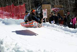 A sled catches air during the Red Bull Schlittentag, aka
