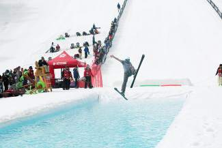 A skier tries to find his balance (and probably fails) at the annual Slush Cup, a pond-skimming competition held at Keystone during closing weekend on April 10.