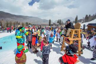 The crowd gathers around the lifeguard stand before the annual Slush Cup pond-skimming event, held every closing weekend at the Mountain House base in Keystone. The event returns this year on April 10.