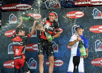 Taylor Phinney (middle) of BMC Racing sprays beer with fellow leaders Brent Bookwalter with BMC Racing (left) in third place and Kiel Reijnen with UnitedHealthcare Pro Cycling (right) in second place as they celebrate their win in the Stage 1 of the USA Pro Challenge in Steamboat Springs on Aug. 17. Phinney scored his first win after 14 months of recovery from a serious injury at the 2014 USA Cyling Road Race championships.