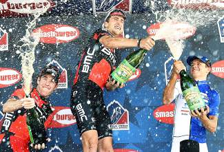 Brent Brookwalter (left), Taylor Phinney (middle) and Kiel Reijnen (right) celebrate their results in typical fashion: by spraying beer on each other and the crowd in downtown Steamboat Springs after taking the podium for the Stage 1 circuit race.