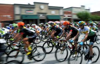 Riders in the 2015 USA Pro Challenge cruise through downtown Steamboat Springs for the start of the Stage 1 circuit race on Aug. 17.