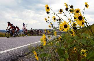 Riders in the peleton make their way along Colorado Route 27 in Routt county during Stage 1 of the USA Pro Challenge in Steamboat Springs on Aug. 17. The 49-mile circuit was completed twice by the racers for a total distance of 96.6 miles for the day's race. Stage 2 will take racers from Steamboat Springs to Arapahoe Basin over a distance of 115.3 miles.