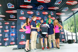 Organizers present Brent Bookwalter of BMC Racing (center) with the Stage 2 winner's jersey.