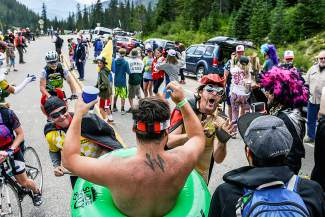 A crowd of costumed race fans waits for the Stage 2 finish of the USA Pro Challenge at Arapahoe Basin on Aug. 18.