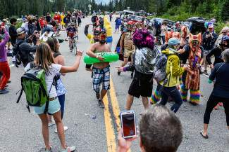 Where's the water? Inner tubes, bacon suits and Colorado flags galore clogged U.S. Highway 6 in preperation for the Stage 2 finish of the 2015 USA Pro Challenge at Arapahoe Basin on Aug. 18.