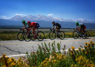 A group of USA Pro Challenge cylists pedals past 14ers in the Leadville area at the midpoint of Stage 3 from Copper Mountain to Aspen on Aug. 19.
