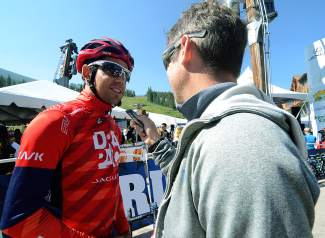 Drapac Pro Cycling ace Lachlan Norris talks with a reporter before the start of USA Pro Challenge Stage 3 at Copper Mountain.