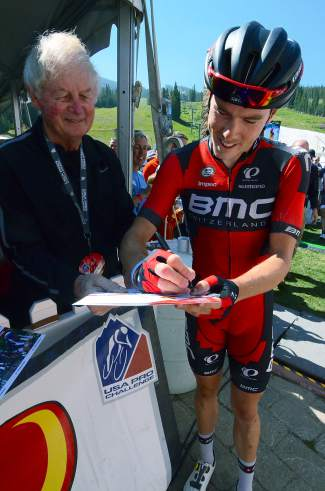 Rohan Dennis of BMC Racing signs autographs at Copper Mountain before the Stage 3 start of the USA Pro Challenge on Aug. 19. Dennis sits in second place overall behind his teammate, Brent Bookwalter.