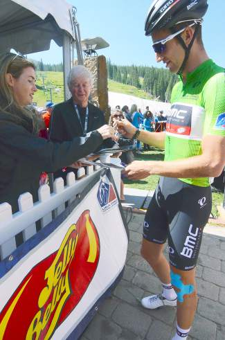 Boulder native Taylor Phinney signs autographs before starting with the green sprint leader's jersey at Stage 3 of the USA Pro Challenge in Copper on Aug. 19.