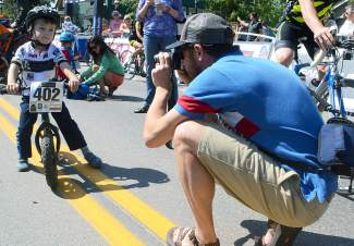 A young cyclist prepares for his close up before the free Strider bike race on Main Street Breckenridge to prep the crowd for the USA Pro Challenge Stage 4 finish on Aug. 20.