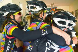 Cyclists with the DNA women's team hug after meeting at Cuppa Joe in Breckenridge before a community ride to recon the Moonstone Road time trial course on Aug. 20, a day before the debut of the Women's Pro Challenge.