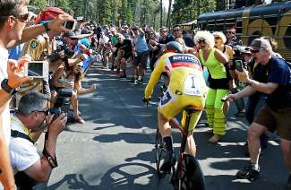 USA Pro Challenge stage winner and race leader Rohan Dennis of Team BMC climbs up Moonstone Road through a tunnel of fans during the Stage 5 Individual Time Trial in Breckenridge Friday Aug. 21.