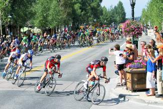 Race fans snap photos as BMC Racing forerunners Brent Bookwalter and Rohan Dennis lead the peloton up Wellington Road on the way to the final hill climb of Stage 4 at the USA Pro Challenge in Breckenridge on Aug. 20.