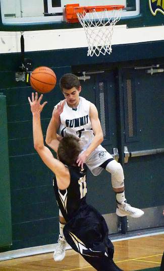 Making it look good: Summit's Turner McDonald gets a foul on Battle Mountain's Creek Kamby during the Tigers grudge match at home on Jan. 12, shot by @louietraub