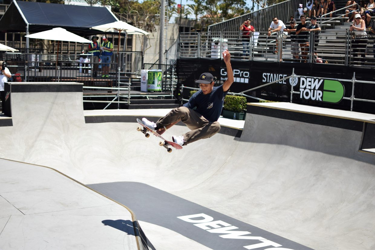 Louie Lopez grabs melon over a hip on the street course at Dew Tour in Long Beach, Califonia this July.