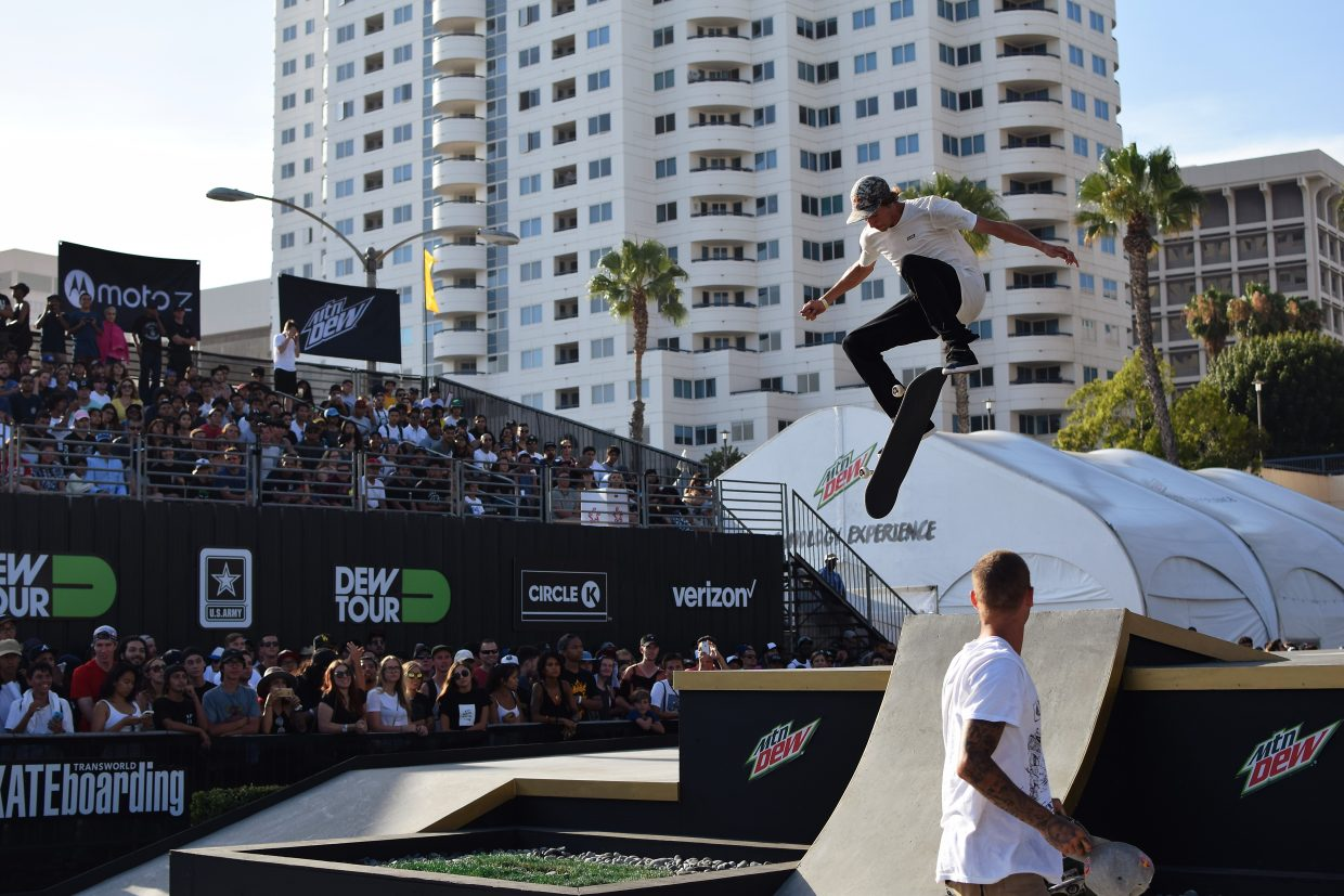 Ryan Sheckler watches as Canadian skater Ryan Decenzo has a tre flip on the street course at Dew Tour in Long Beach, California this July.