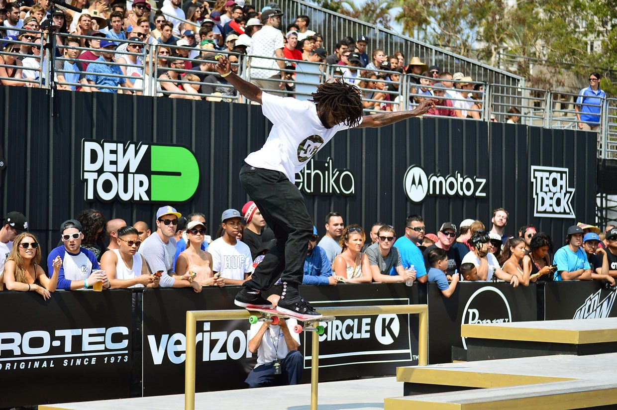 Cyril Jackson with a frontside tailslide on the street course at summer Dew Tour in Long Beach, California in July.