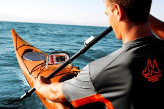 The Motionize virtual kayak coach mounted to the front of a lake kayak. The system analyzes your movements for a more effective paddle stroke.